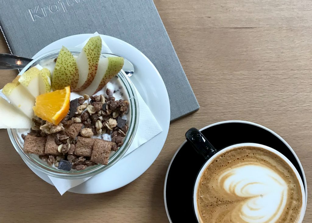 Coffee and granola on a table