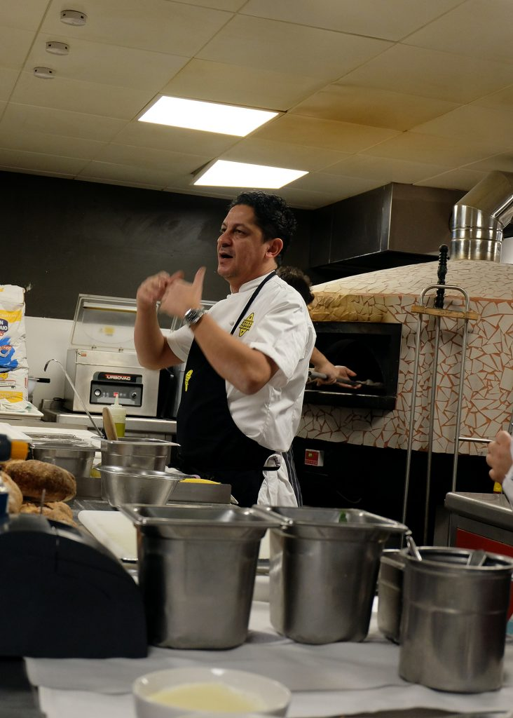 Francesco Mazzei in the kitchen talking